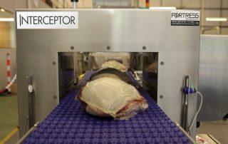 Fortress Interceptor Metal Detector With Meat on Conveyor