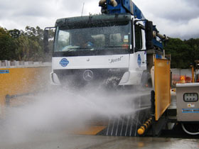 Truck in wheel wash system