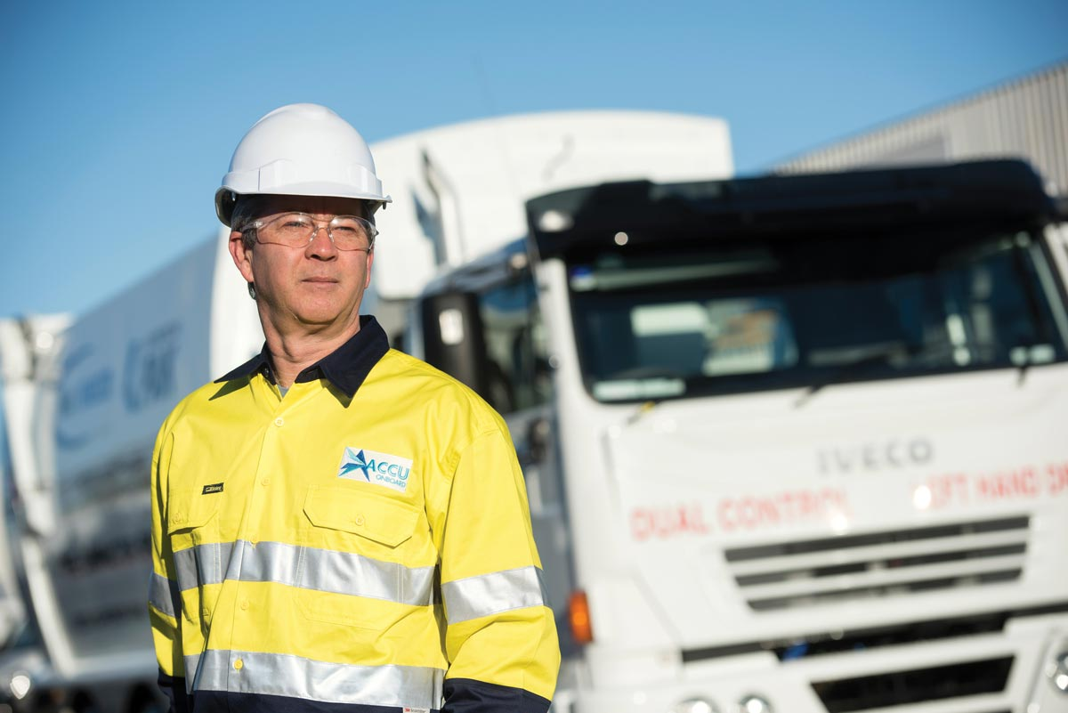 AccuOnboard Service Technician in front of a waste collection truck