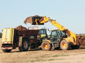 Digger fitted with Alpha 10 weighing system