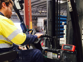 Forklift fitted with onboard scales