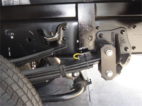 VanWeigh sensor fitted to leafspring suspension of a light commercial vehicle