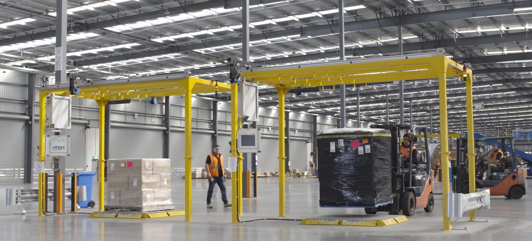 Two CubiScan 1200 AKL legal-for-trade automated pallet dimension systems in use at an Australian express freight service provider.
