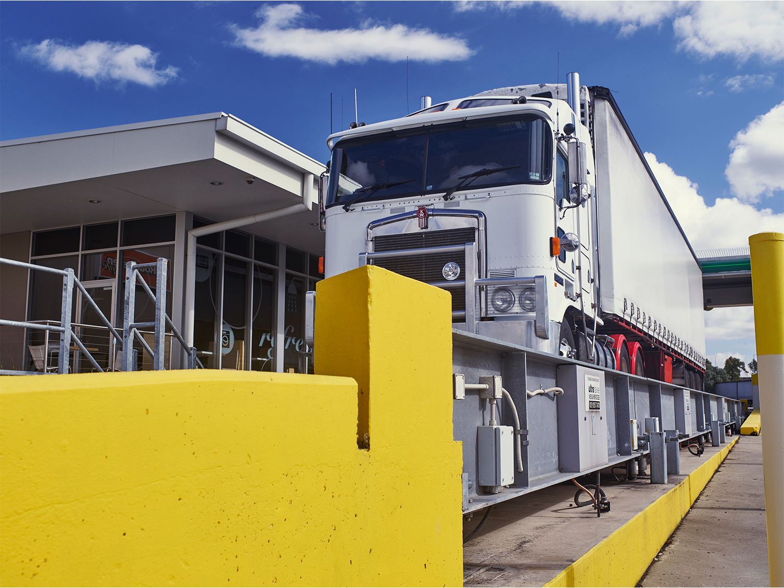 Above ground weighbridge truck stop